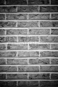 brick wall background in black and white with vignetting