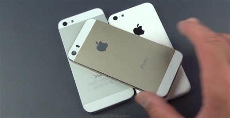 Casing Motorola E360 Gold And Silver golden iphone 5s casing leaks in a alongside white