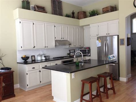 should i paint my kitchen cabinets what color should we paint our kitchen cabinets