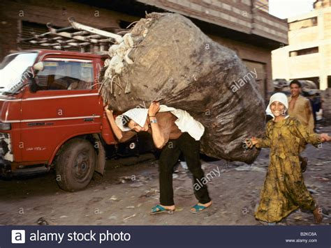 Picture Of Someone Carrying A Heavy Load carrying a heavy load cairo stock photo