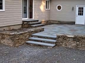 back door steps raised patio ehrmentraut landscape