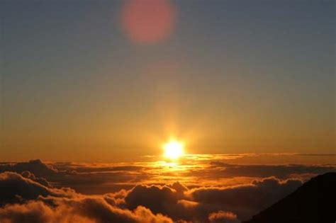 Sun Is Up sun partially risen picture of haleakala crater