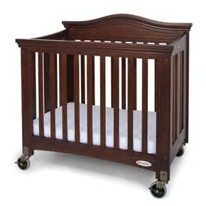Foundations Mini Crib Foundations Royale Folding Compact Crib Antique Cherry