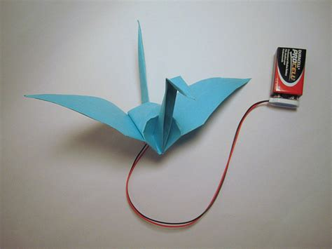How To Make A Paper Swan That Flaps Its Wings - origami crane flaps its wings with memory alloy make
