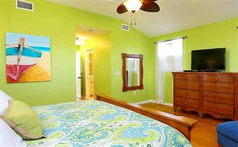 lime green walls in bedroom beach cottage with bright blue yellow lime green
