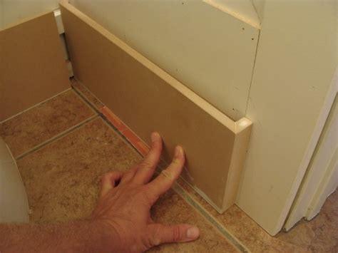 half bathroom renovation installing the baseboard fascia