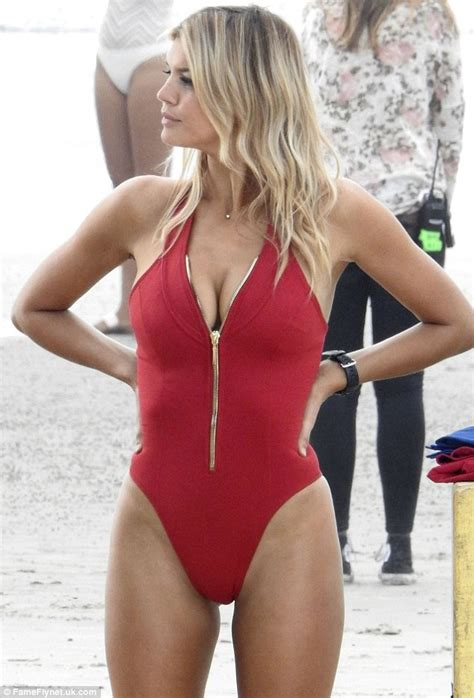 Puts On Baywatch Suit by Rohrbach Slips Back Into Swimsuit For