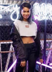 chanel iman victoria secret angel chanel iman flashes midriff in crop top and skinny pants