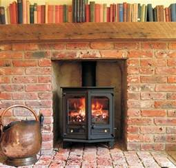 brick fireplace with log burner log burners