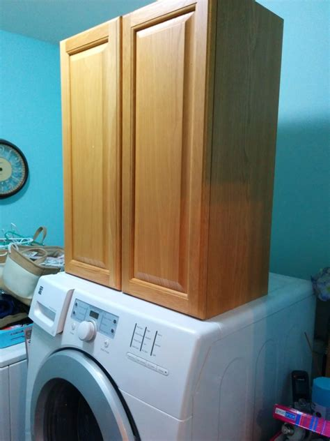 installing laundry room cabinets how to install cabinets in laundry room our house now a