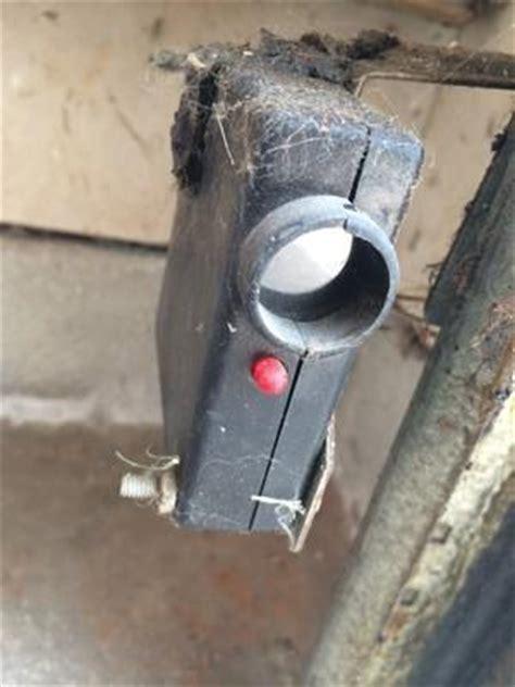 Garage Door Sensor Blinking why is one garage door sensor blinking and the