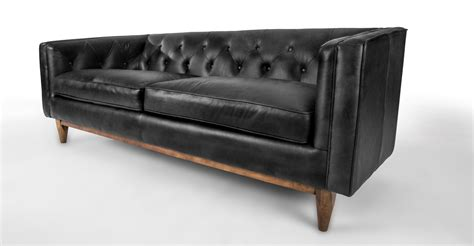 black modern sofa black leather sofa in walnut wood finish article alcott modern furniture scandinavian