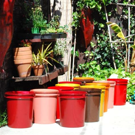 spray painted  gallon buckets garden pots works