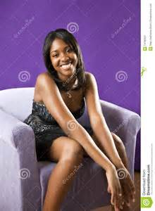 Pretty african american teenager sitting relaxed on a chair