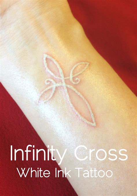white cross tattoo beautifully done white ink of an infinity cross