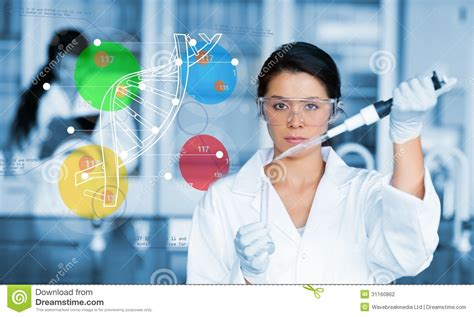 serious chemist working with colourful dna helix diagram
