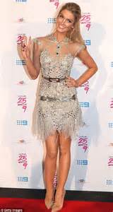 Delta Goodrem glitters in a seimi transparent silver mini dress in Sydney   Daily Mail Online