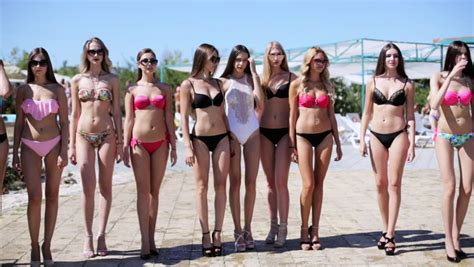 defile young models defile of young women in bikinis in the aquapark stock