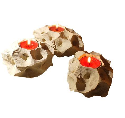 candele scolpite tris di porta candele in pietra leccese scoglio