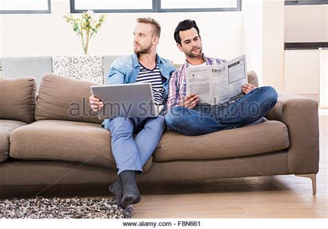 gay on the couch gay couple relaxing sofa stock photos gay couple
