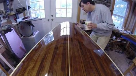 finishing teak wood on a boat applying varnish for a smooth reflective finish on a