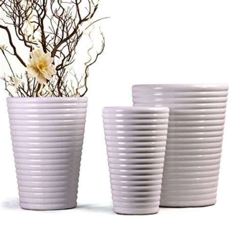 White Ceramic Planters by White Coil Ceramic Planters