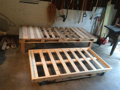diy pallet bed with storage tutorial diy pallet day bed with roll out trundle pallets tutorials and bedrooms
