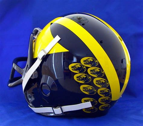 michigan helmet design history what do the stickers on michigan state football helmets