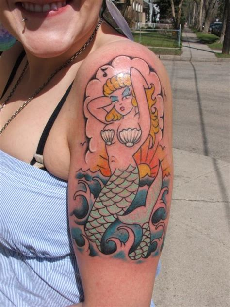 sailor jerry style mermaid rites of passage tattoo