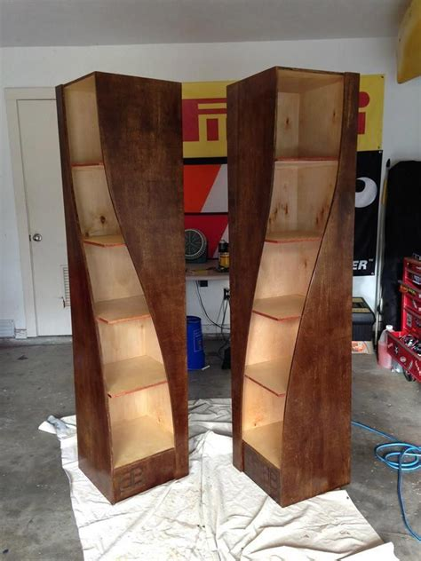 twisted wooden bookshelves