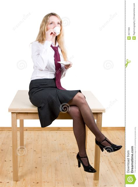 Sitting On by A Sitting On A Table Royalty Free Stock Images