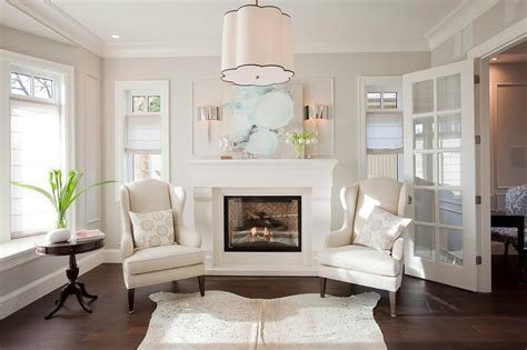 Polished Nickel Half Moon fireplace with wingback chairs transitional living