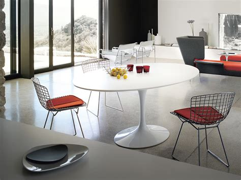 mixing modern chairs with antique table tulip chairs go buy the knoll saarinen tulip dining table oval at nest co uk