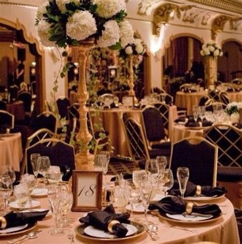 Tall centrepieces with white flowers and gold details