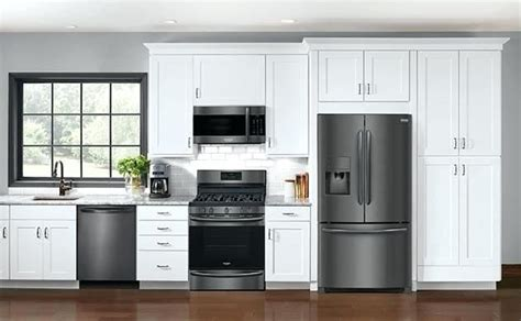 cream colored kitchen cabinets  black stainless steel