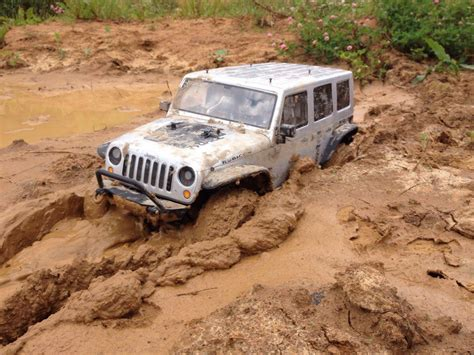 muddy jeep wrangler rc jeep wrangler jk in mud axial scx10