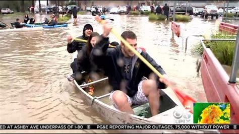 rowboat in a flood storm floods parking lot at healdsburg safeway becomes