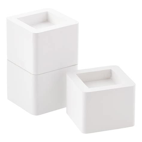 bed riser set of 4 white solid wood bed risers the container store