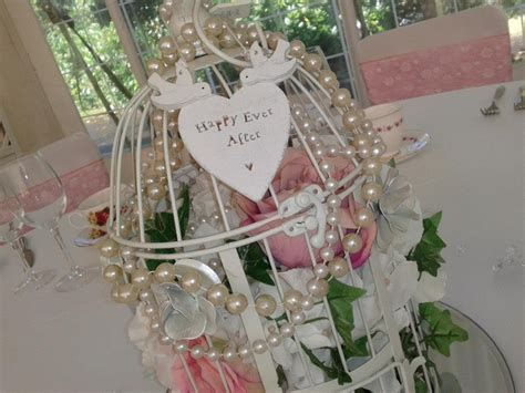 Too Many Flowers But I Like The Beads Lisa S Wedding Birdcage Centerpieces Weddings