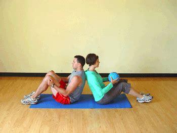 partner seated torso twist with medicine exercise demonstration get fit medicine
