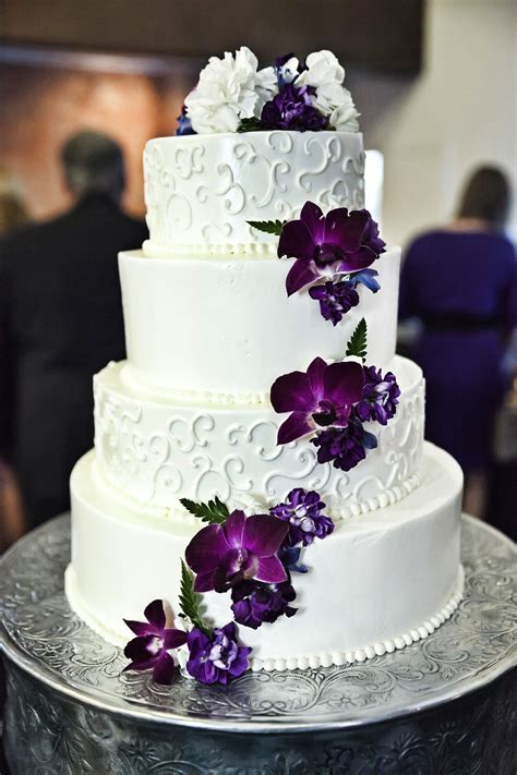 White and purple wedding cake with cascading purple