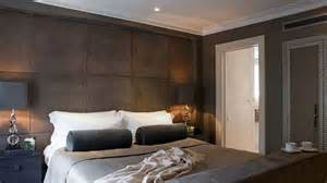 hotel style bedroom rich chocolate suede padded wall with cappuccino and