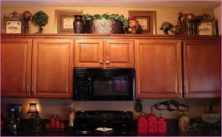 Ideas For Decorating Above Kitchen Cabinets Decorating Top Of Kitchen Cabinets