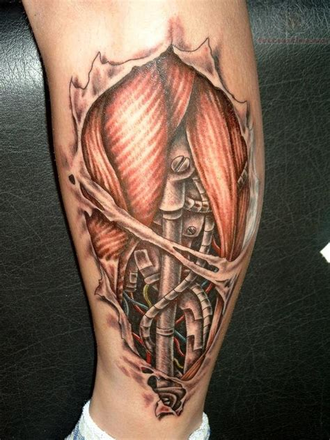 bio mechanical rip skin tattoo on leg