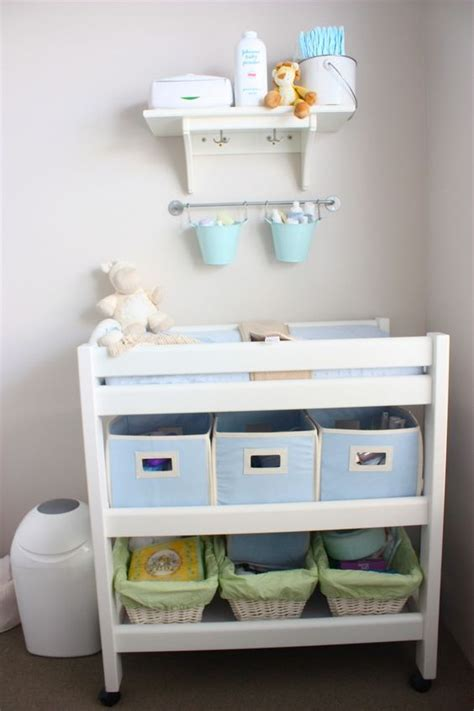 Organize Changing Table The Idea Of Hanging Pales Above Changing Table To Organize Store Nursery Ideas