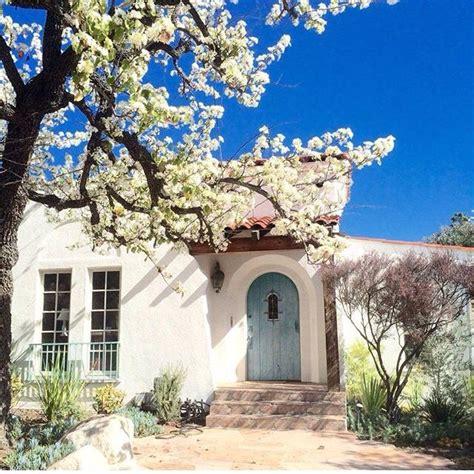 spanish stucco homes white stucco blue door stone pavers spanish