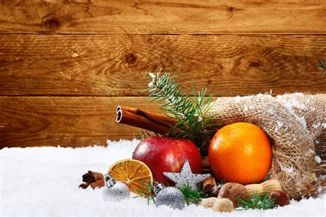 apples and oranges for new year new year snow orange apple cinnamon 4k wallpaper