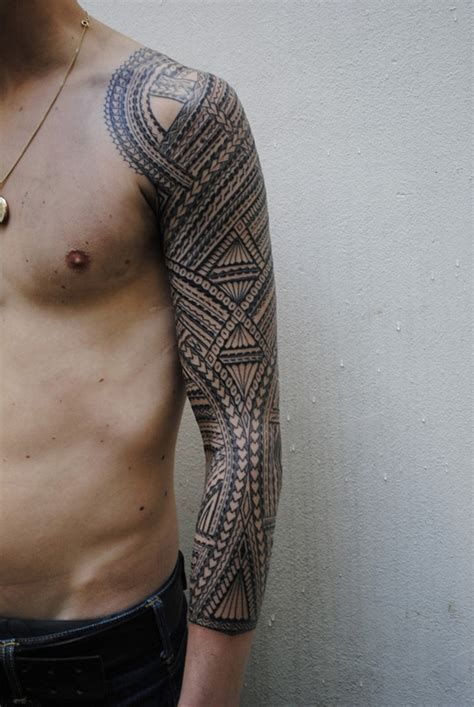 large tribal tattoo big black and white sleeve of tribal style
