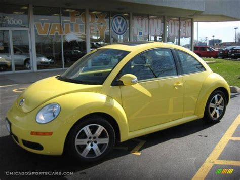 volkswagen yellow yellow beetle car inside