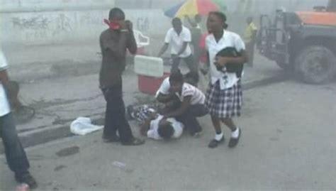 Haiti children caring for other children school girl overcome by earthquake